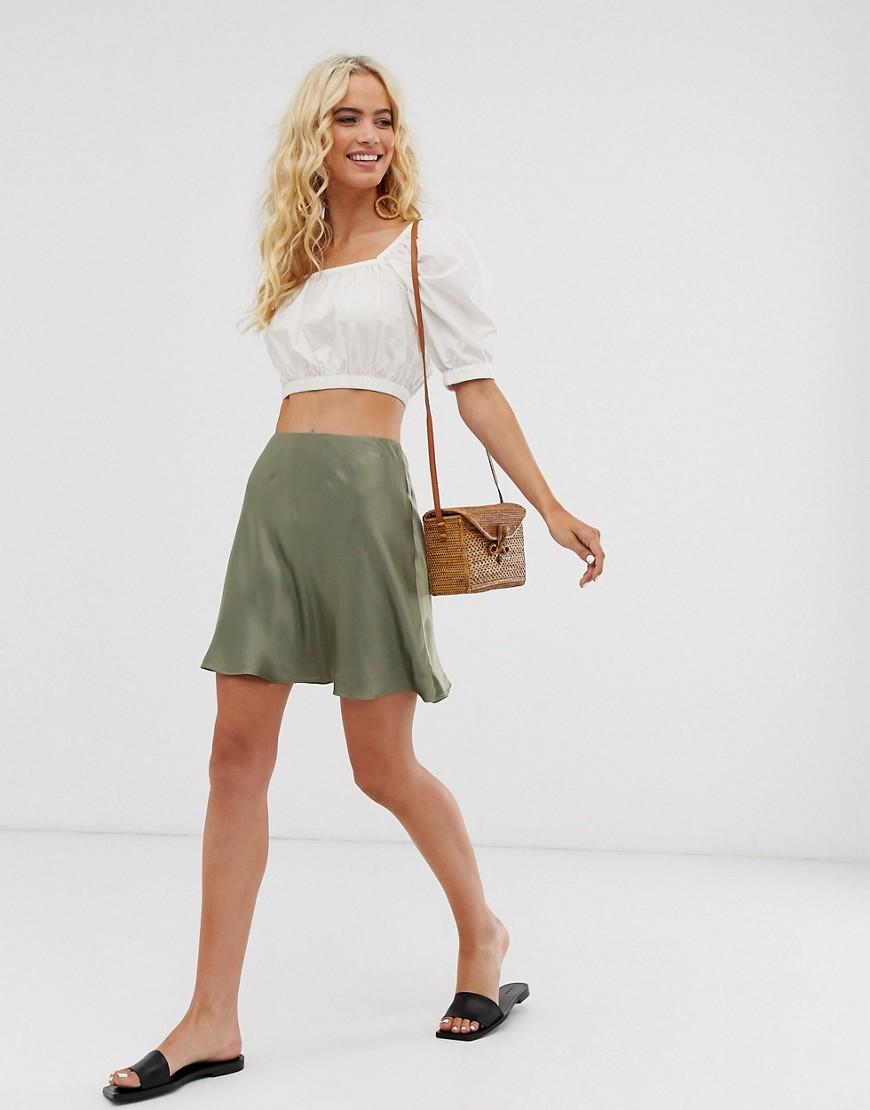 Minifalda plisada de lino con botones en la parte delantera y bolsillos de ASOS DESIGN Curve asos gris Acampanada