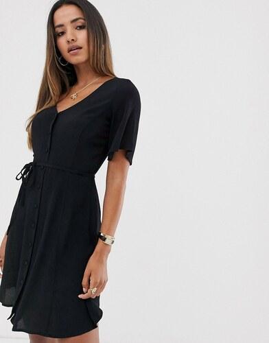 Vestido negro con botones en la parte delantera de Mango